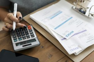 landlord using calculator and property statement to file taxes